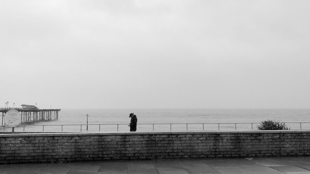 Lone figure on a wet seafront @MandyPearse